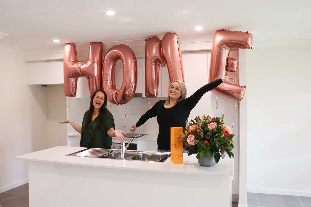 Sisters Mariah and Chantel celebrating the handover day of their brand new first home.